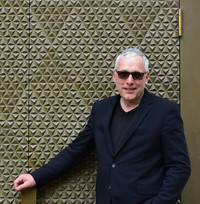 Felix Gothart, the chairman of Bayreuth's Jewish community in the Franconia region of Germany, stands in front of the doors of the renovated synagogue. Photo courtesy of Candyce Stapen.