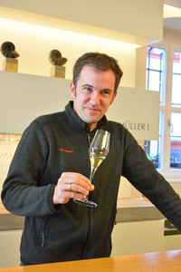 Christian Muller, vintner of Max Muller I winery in Volkach, Germany, samples a glass of his wine. </p> <p>Photo courtesy of Candyce H. Stapen.