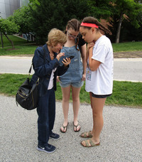 . The author's wife, Fyllis, granddaughter Mollie and friend Ingrid consult clues on an Urban Adventure Quest scavenger hunt. Photo courtesy of Victor Block.