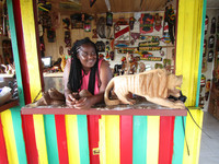A souvenir vendor's smile captures Jamaica's friendly spirit. Photo courtesy of Victor Block.