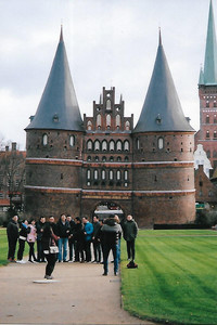 A group of tourists poses in front of the historic 540-year-old Holsten Gate, which welcomes visitors to the Old Town of Lubeck, Germany, a UNESCO World Heritage Site. Photo courtesy of Sharon Whitley Larsen.