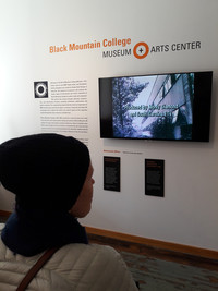 A visitor views a video at the Black Mountain College Museum and Arts Center in Asheville, North Carolina. Photo courtesy of Steve Bergsman.