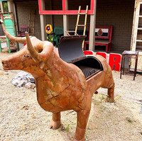 A metal bull serving as a barbecue grill stands by an artisan shop in Cave Creek, Arizona. Photo courtesy of Nicola Bridges.
