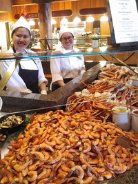 After a day of skiing, friendly faces welcome hungry guests at Deer Valley Resort's Seafood Buffet in Park City, Utah, where a cornucopia of crab legs, shrimp, oysters, prime rib and more await. Photo courtesy of Athena Lucero.