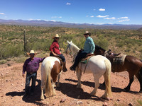 Guests at Rancho de los Caballeros in Wickenburg, Arizona, take time during a ride to enjoy the scenery. Photo courtesy of Nicola Bridges.
