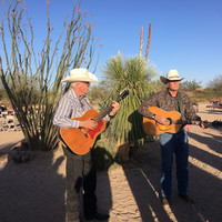 Cowboys entertain guests at Rancho de los Caballeros in Wickenburg, Arizona, during a hayride and cowboy cookout. Arizona. Photo courtesy of Nicola Bridges.