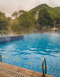 One of the hot pools at Tongjing Springs, near Chongqing, China, overlooks the adjacent river and bamboo-covered hills. Photo courtesy of Lee Daley.