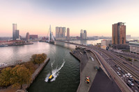 "The skyline of Rotterdam, Netherlands, includes the Erasmus Bridge, nicknamed ""The Swan"" because of its elongated pylon. Photo courtesy of Claire Droppert."