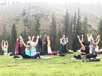 Participants in one of Yogi D's Colorado retreats greet the morning with outdoor yoga. Photo courtesy of Nicola Bridges.