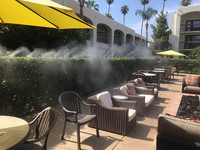 A cooling mist refreshes visitors enjoying the patio at the Palm Mountain Resort in Palm Springs, California. Photo courtesy of Nicola Bridges.