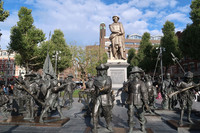 "A sculpture on Rembrandt Square in Amsterdam depicts the artist surrounded by subjects he painted in ""The Night Watch."" Photo courtesy of Barbara Selwitz."