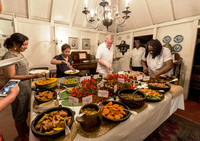 Visitors to the Caribbean island of Nevis select side dishes at a pig roast at the Hermitage Inn. Photo courtesy of Fyllis Hockman.