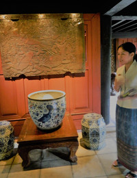 A guide discusses an artifact at the Jim Thompson House in Bangkok, Thailand. Photo courtesy of Steve Bergsman.