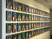 "A wall containing 76 modern-art portraits of ""New York City's Golden Boys"" from 1946-60 is on display at the Yogi Berra Museum and Learning Center in Montclair, New Jersey. Photo courtesy of Nicola Bridges."