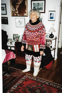 """A native Greenlander, hosting a """"Kaffemik"""" in her home, wears a traditional costume. Photo courtesy of Sharon Whitley Larsen."""