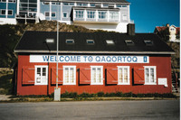 A typical bright-colored building in Qaqortoq welcomes visitors arriving on a cruise ship. Photo courtesy of Sharon Whitley Larsen.