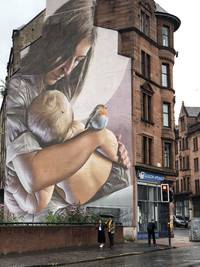 Murals on the sides of buildings in Glasgow, Scotland, are one way the city celebrates the arts. Photo courtesy of Candyce Stapen.