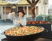 Shirley Tolar makes a meal in a giant skillet at Silver Dollar City in Branson, Missouri. Photo courtesy of Silver Dollar City.
