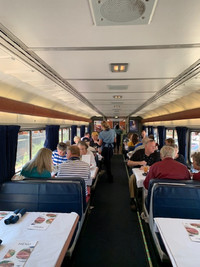 Passengers on the Coast Starlight enjoy lunch as they meet new friends in the dining car. Photo courtesy of Sharon Whitley Larsen.