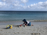 A toddler plays at Grace Bay Beach in Turks and Caicos. Photo courtesy of Candyce Stapen.