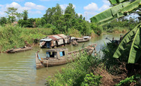 Wooden boats ply the Mekong River in Southeast Asia. Photo courtesy of Doug Hansen.