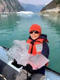 A child finds bits of an iceberg during an Alaskan cruise on the S.S. Legacy. Photo courtesy of Margot Black.
