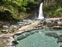 An onsen nestles at the base of a waterfall along Japan's Izu Geo Trail. Photo courtesy of Margot Black.