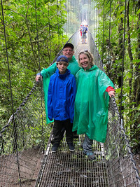 The author and her family brave the rain to walk across a hanging bridge at Arenal, Costa Rica. Photo courtesy of Margot Black.