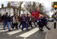 """""""In the Life"""" Beatles walk guide Richard P. leads a group across London's Abbey Road. Photo courtesy of Richard Porter."""