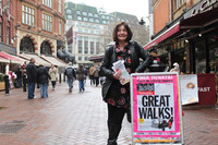 """Guide Karen waits near Leicester Square in London for participants to arrive for the """"Theatreland Walk."""" Photo courtesy of Adam Scott."""