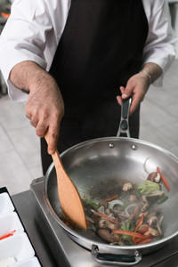An online cooking instructor demonstrates how to saute. Photo courtesy of Golubovystock/Dreamstime.com.
