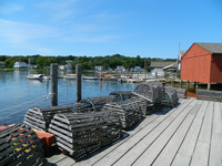 Lobster traps wait on a dock in Mystic Seaport, Connecticut. Photo courtesy of Steve Bergsman.