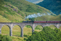 A Jacobite steam train crosses the Glenfinnan Viaduct in Scotland, just as the Hogwarts Express does in the Harry Potter movies. Photo courtesy of David Gonzalez Bebolio/Dreamstime.com