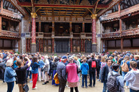 Visitors to the Globe Theater in London check out the ceiling, which is a reproduction of the original. Photo courtesy of Kmiragaya/Dreamstime.com.