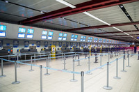 The COVID-19 pandemic has caused airport ticket counters and check-in desks to be all but deserted. Photo courtesy of Oriontrail/Dreamstime.com.