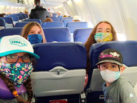 In the time of pandemic planes are nearly empty and passengers must all wear masks. Photo courtesy of Ariane Nicholson.