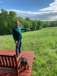 Kevin Dallman gestures toward the meadow that attracts birds and bees to the Silver Star Inn near Spring Green, Wisconsin. Photo courtesy of Brian Clark.