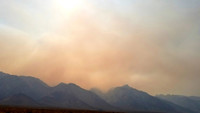 Smoke from a California wildfire crawls menacingly across the Sierra Madre Mountains. Photo courtesy of Jim Farber.