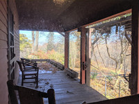 The wraparound porch at the T.C. Steele State Historic Site in Brown County, Indiana, is one of the places where the artist could take inspiration for his Impressionist paintings. Photo courtesy of Athena Lucero.