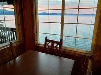 The dining area of a Zephyr Point Cabin on the Nevada side offers spectacular views of Lake Tahoe. Photo courtesy of Margot Black.