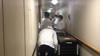 Crew members serve meals to quarantined passengers on the Diamond Princess. Photo courtesy of Philip Courter.