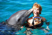 The author swims with Romeo the dolphin at the Dolphin Academy, Curacao Sea Aquarium. Photo courtesy of Victor Block.