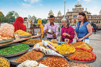 Members of an Overseas Adventure Travel tour group visit a spice market in India. Photo courtesy of Grand Circle Corp.