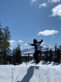 The author's son jumps on a snowboard at Mammoth Mountain, California. Photo courtesy of Margot Black.