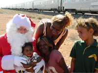 """Children in a small Australian village greet the man they call """"Ho Ho"""" during a stop by Indian Pacific Railway's Christmas Train. Photo courtesy of John Blanchette."""
