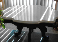 Marble-top table is circa 1875.
