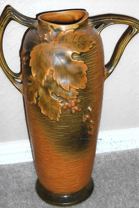 "Roseville Pottery introduced its ""Bushberry"" pattern in 1948."
