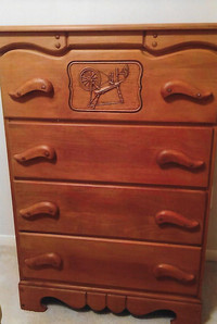 Hard rock maple bedroom furniture with motifs in relief were made in the 1950s.