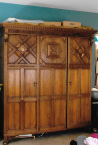 Armoire is a blend of two periods of design.