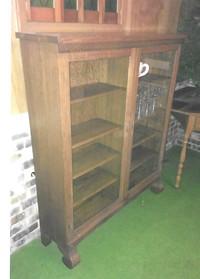 Oak cabinet is circa 1900.